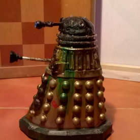 A custom Dalek painted to resemble the Emperor's Guard with added damage