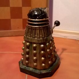 A custom Emperor's Guard Dalek with added damage, seen from behind